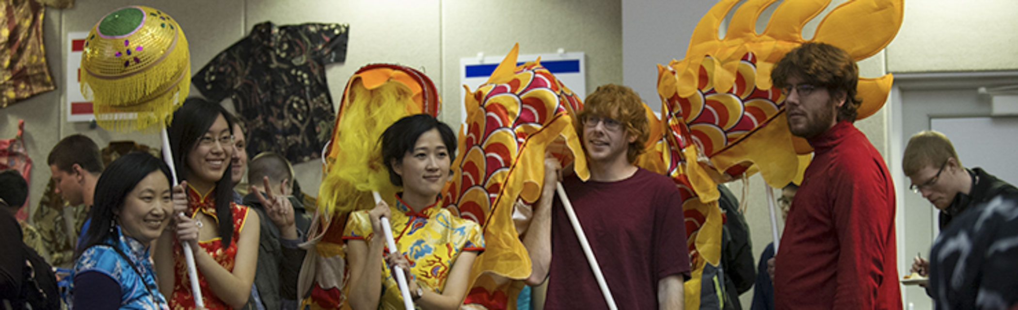Students getting ready to perform the dragon dance at the Food Expo