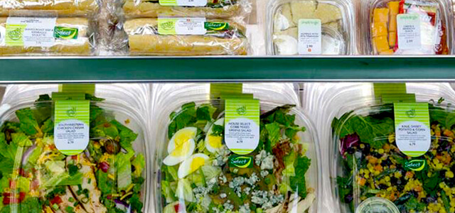 refrigerated area at Simply to Go where there are packaged salads, sandwiches, and various other cold snacks